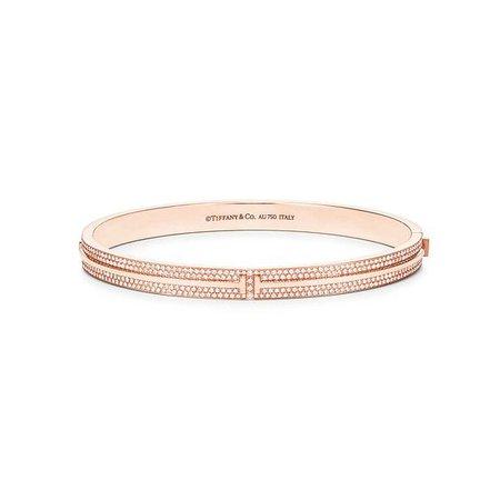 Tiffany T Two hinged bangle in 18k rose gold with pavé diamonds, medium. | Tiffany & Co.